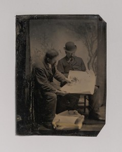 [Two Men Reviewing Plans]